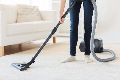 Residential Cleaning in Charlotte TN - vacuuming carpets